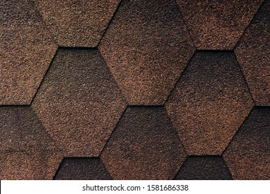 Soft shingles tiles closeup. The texture of the roof of the roof, made of shingles. The texture of shingles.