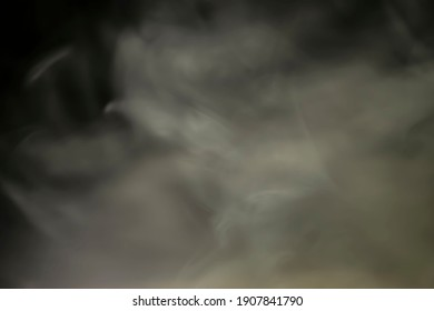 Soft smoke on a black background. You can use this as a web designs backdrop and just as an overlay.