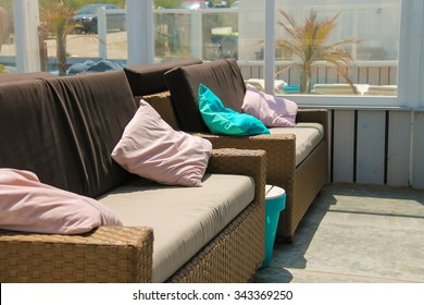 Soft sofas with colorfull pillows in the beach cafe terrace. Zandvoort, the Netherlands