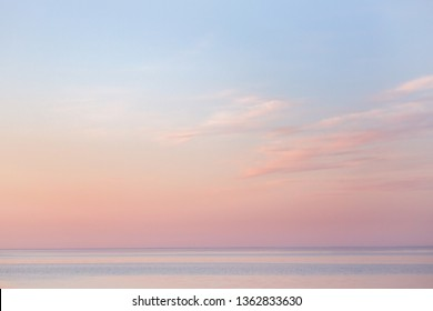 soft summer sunset over the bay,  beautiful horizon pink clouds and water