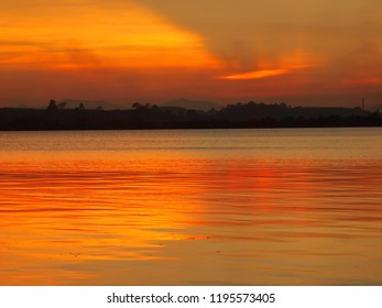 A soft sunset bacground of blended yellows on a calm ocean in east Thailand