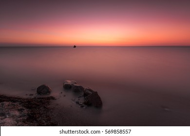 Soft sunset on the sea with rocks