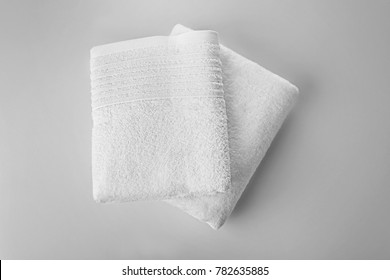 Soft terry towels on light background, top view