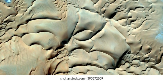 soft texture, creamy, pale yellow, polished sand, abstract photography of the deserts of Africa from the air, bird's eye view, abstract expressionism, contemporary art, optical illusions,