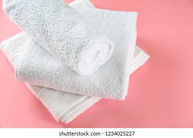 Soft towels on color background