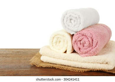 Soft towels on table isolated on white