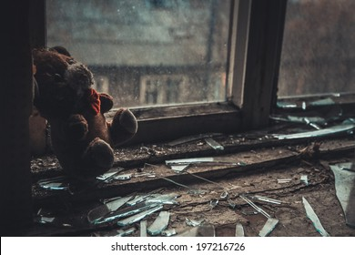soft toy on the windowsill in the empty abandoned apartment