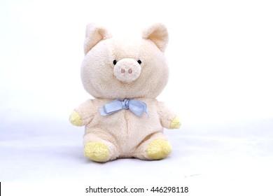 soft toy pig on white background.