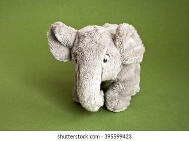 Soft toy a plush elephant on green background