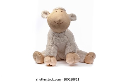 Soft toy sheep isolated on white
