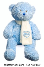 Soft toy teddy isolated on white in a seated position. Very soft plush fur intended as first bear for a newborn baby.