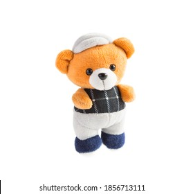 Soft toy-a brown bear in a gray cap and pants, a checkered t-shirt. Isolate on a white background. children's toy. space for text