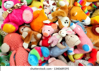 a lot of  soft toys, use as background, colored large and small, top view