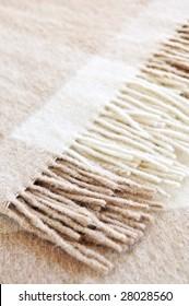 Soft and warm folded alpaca wool blanket with fringe