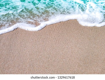 Soft wave of blue ocean on sand beach. Background.