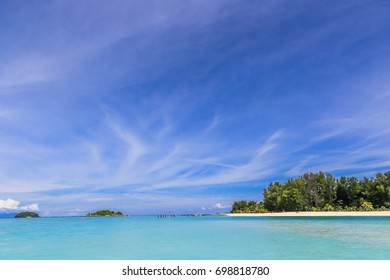 Soft wave of blue ocean on sandy beach.Lipe. Background.soft focus.