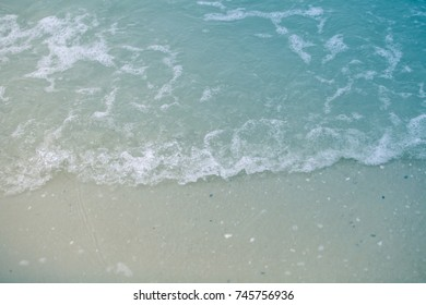 Soft wave of blue ocean on sandy beach,Background,landscape,water  blue sea.