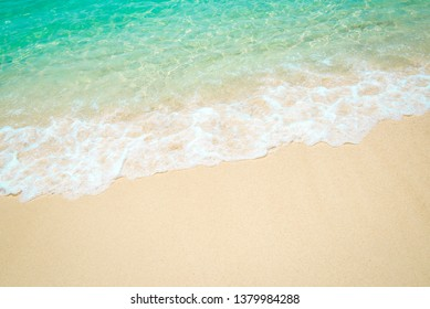 Soft Wave Of Blue Ocean selective focus on sandy beach On Sandy Beach Background. Copy space for text