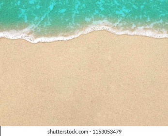 Soft wave of blue sea on the sandy beach. Background.