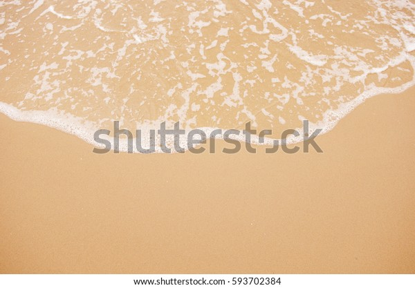 Soft wave lapped the sandy beach, Background.