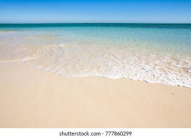 Soft wave on the sandy beach of the blue lagoon