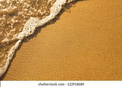 Soft wave of the sea, beach sand texture.