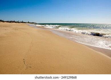 Soft wave of the sea on the sandy summer beach