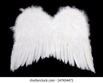 Soft white angel wings isolated on black