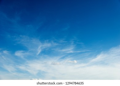 Soft white clouds against blue sky.