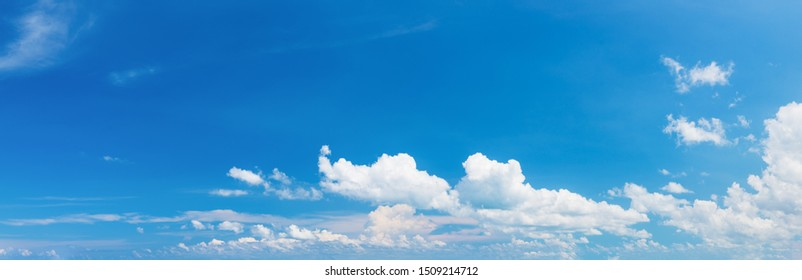Soft white clouds against blue sky ,Panoramic fluffy clouds in the blue sky