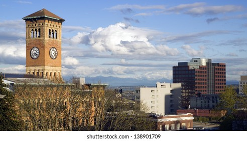 Soft white clouds surround the old City Hall Building and the Tacoma Washington skyline Mt. Rainier obscured, United States