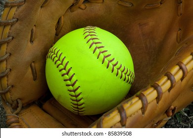softball with accessory