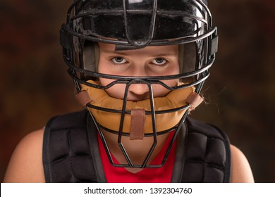 Softball catcher with mask on