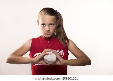 Softball girl with ball in hands