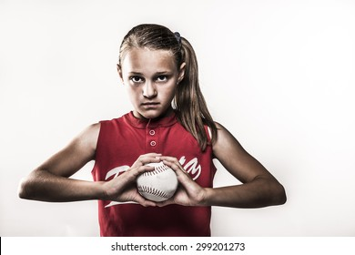 Softball girl with ball in hands retro
