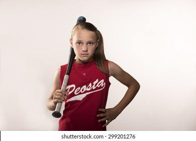 Softball girl with bat on shoulder