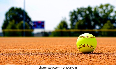 Softball on Softball Field with Dirt