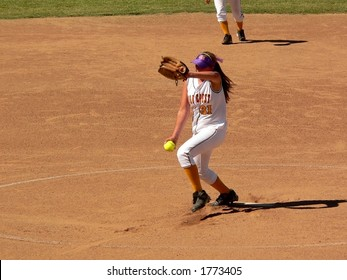 Softball Pitcher in middle of Windup