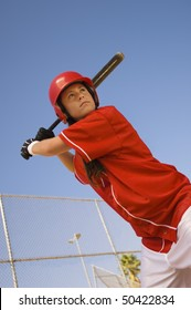 Softball player at bat, portrait, low angle view