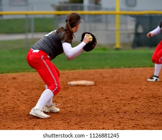 Softball Player Making a Throw for an Out