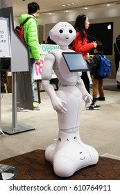 A Softbank Pepper robot on customer service duty at the front of a Softbank store in Ginza, Tokyo. Photo taken January 2017.