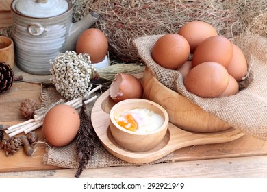 soft-boiled egg and eggs on wood background