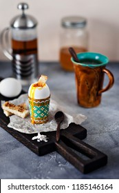 A soft-boiled egg with toast on a wooden Board.  Healthy fitness Breakfast.