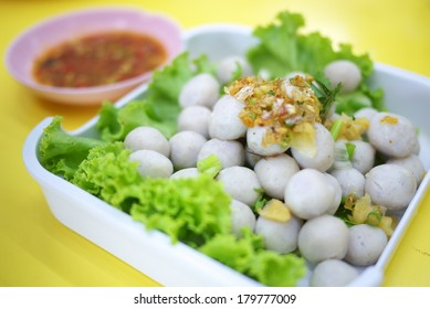 Softboiled fish balls in Thai-style served with chilli and sour sauce