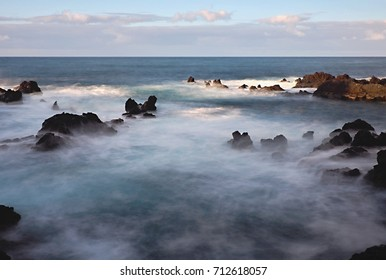 softened Atlantic by HD filter, at the time of the ebb, the rocks and lava stones protrude from the water
