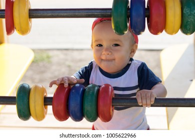Soft-focus portrait of a boy standing near giant counting frame with tricky face. Smart financial decisions concept