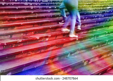Softly textured image in rainbow colors of young peoples feet dancing on stairs.