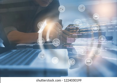 Software developer coding computer program with augmented reality dashboard, mobile app design, internet  icons on VR screen. Man using mobile phone, business intelligence, IT technology development