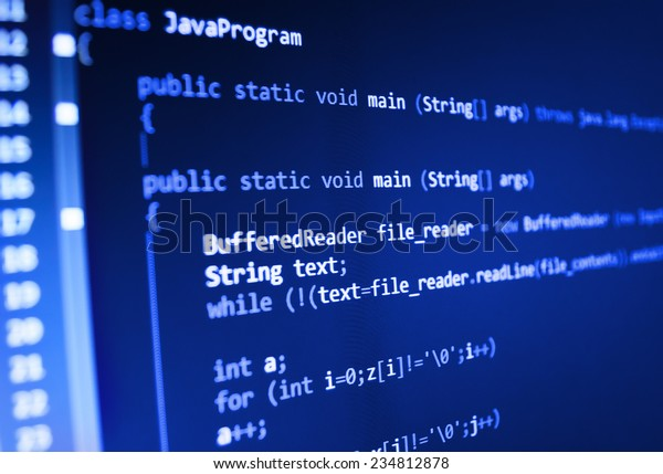 Software developer programming code. Abstract computer script  code.  Selective focus. Blue color.  Vignette light and dark shadow dramatic effect.  (MORE SIMILAR IN MY GALLERY)