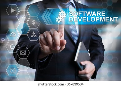 Software development concept. Businessman pointing on virtual screen with text and icons.